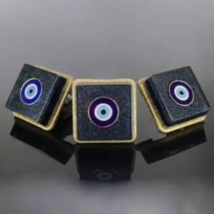 Mentoria - Kit com 3 Orgonites Quadrado com Borda - Pingente Olho Grego Dourado